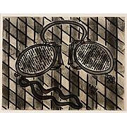 Brille auf grauen Karos